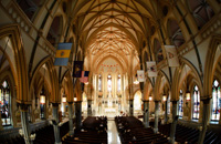 wide photography of a beautiful church during a wedding ceremony