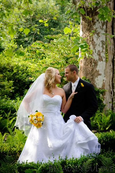 bride and groom pose romantically