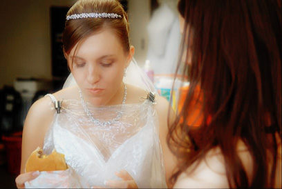 Photo of Bride in a Private Moment with Her Friends by Wedding Photographer