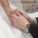 Close up of photograph of bride and groom holding hands