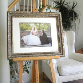 Framed photograph of groom proposing to bride