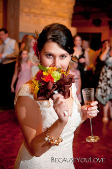 In this photograph wedding photographer pennsylvania photographs the bride getting ready to toss her flower bouquet