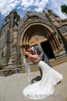 In this photograph the wedding photographer pennsylvania photographs the bride and groom embracing in front of a church