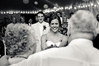 Journalistic photo of the bride presenting a present to her grandparents