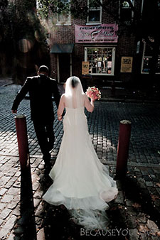 The bride and groom escape after their ceremony on Second Street, in Philadelphia, PA