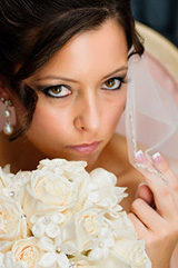 journalistic photograph of the bride holding her flowers