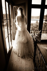artisitc photograph of bride in doorway