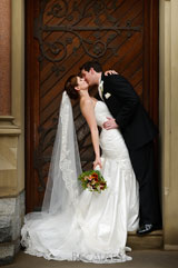 romantic photograph of the bride and groom kissing