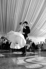journalistic photograph of the bride and groom having their first dance